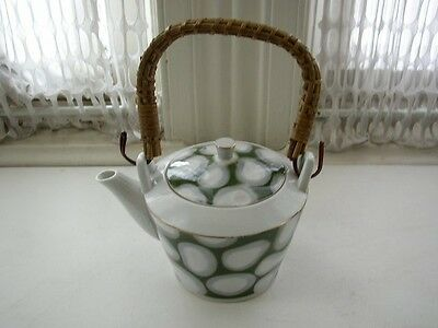 Vintage, 3.5in x 5.5in Child's Porcelain Teapot with Wicker Handle