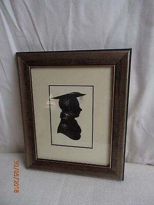 pair of mounted and framed silhouette prints in silver and black frames