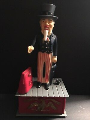 UNCLE SAM IRS July 4th MECHANICAL PLASTIC COIN BANK - WORKS! - AMERICANA
