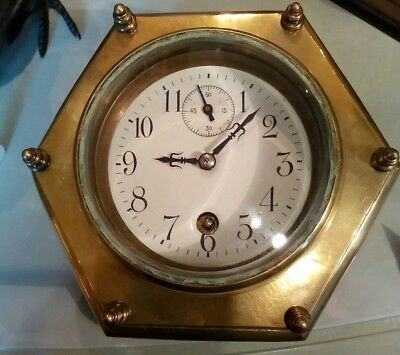 antique brass desk clock, 8 day movement, lovely condition and unusual