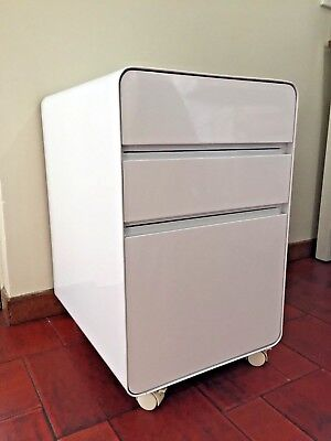 White, powder coated, three-drawer storage unit with lockable wheels