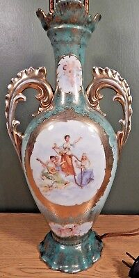Antique Ornate Vase Lamp With Heavy Gilding And Cherub Decorations