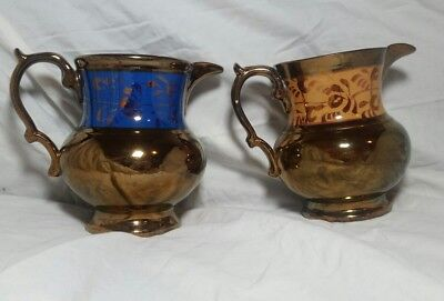 (2) VINTAGE COPPER LUSTER CREAM PITCHERS, blue, gold and copper