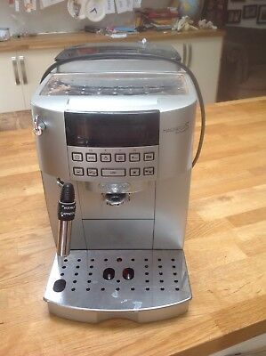 delonghi coffee maker. Black and silver. Bean to cup