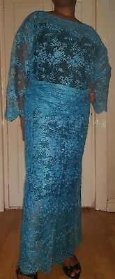 African Ladies turquoise blue floral design net lace buba and wrapper /iro