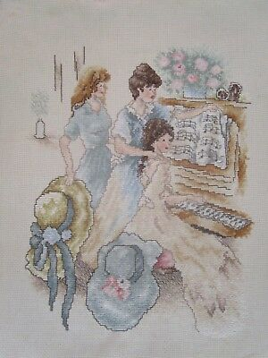 Completed Cross Stitch Of 3 Girls At A Piano 2 Of Them With Hats