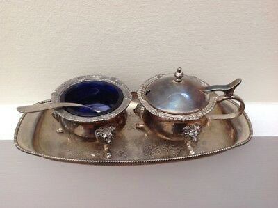 A Vintage Silver Plate Salt and Mustard Set with Spoon and Tray with Blue Glass