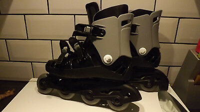In-line skates. Argos black and grey size 4/5 with pad set.