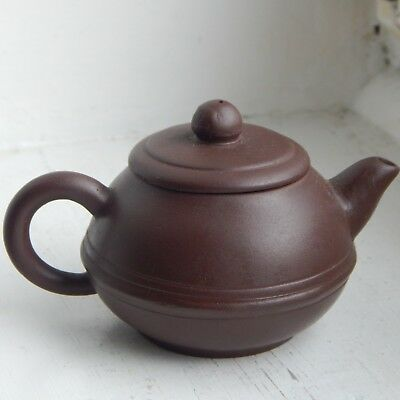 An unsual signed Chinese miniature yixing teapot in fine condition