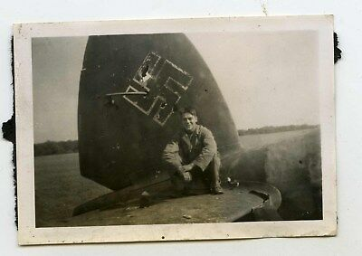Original photo of a captured HE111 bobmer with GI sitting on tail