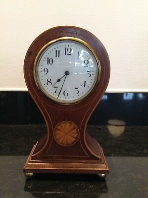 Antique English flame mahogany balloon clock on ball feet with original key