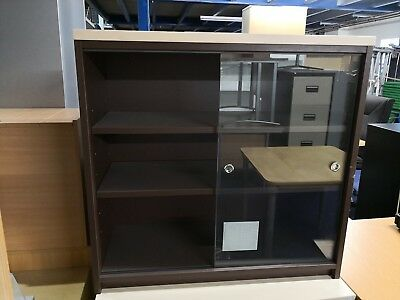 (Item125) Used Brown Cabinet with Cream Top and Glass Sliding Doors