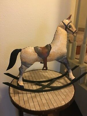 Handmade brown & yellow Unique rocking horse.  Made of tin on iron base.