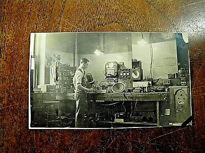 Early Photo Man Working on Old Radios