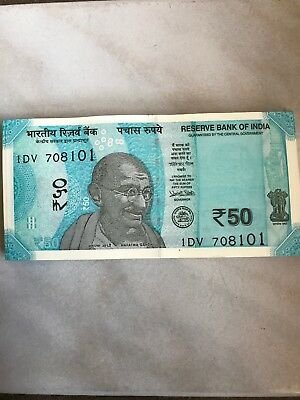 New Indian 50 Rupees currency note Mahatma Gandhi in the front Hampi on the Back