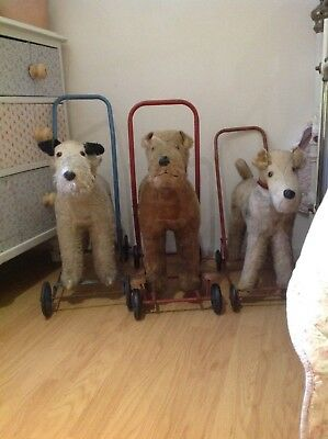 Vintage dog on wheels,fox terrier toy dog,ride along,baby walker.chiltern.1950s