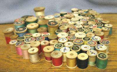 Lot of 100 Vintage Wooden Spools, most with Thread