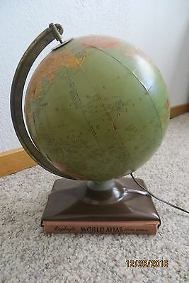 Old Replogle tabletop globe, lighted, glass with faux wood book base, 1939,