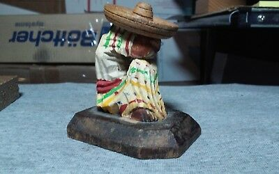 Vintage,old hand carved,painted wooden mexican man taking a siesta