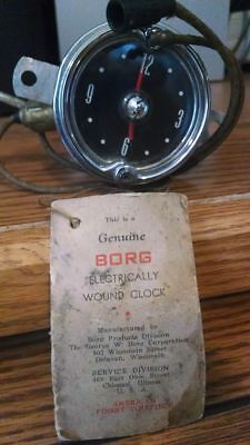 Vintage 1954 Borg electric car boat airplane clock with original tag and maual