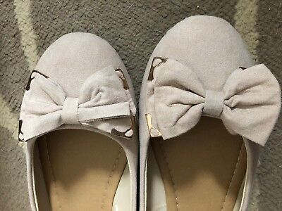 Ladies light pink flat ballerina shoes with bow detail from Primark. Size 7.