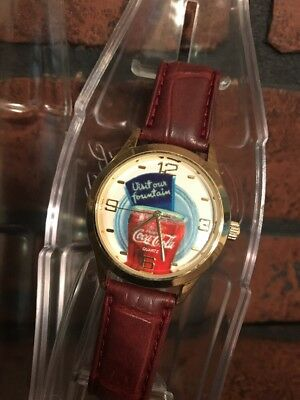 Coca Cola Coke Wrist Watch In collectible Bank case 2002