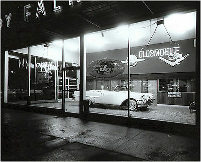 1957 Cadillac In Showroom at Night Caddy Olds dealership  8 x 10 Photograph