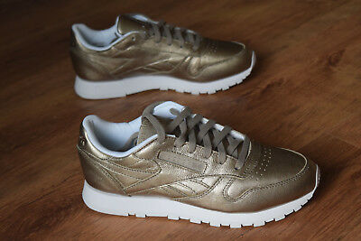 f4492ffa7fb87 REEBOK CLASSIC LEATHER Melted Metal Gold White Women s Running Shoes ...