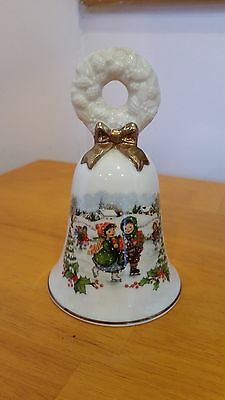 Avon Collectible 1986 Porcelain Christmas Bell with Ice Skaters Wreath on Top