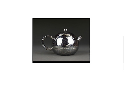 JAPANESE  SILVER  Artists' sterling silver old hammer eye statue muzzle teapot.