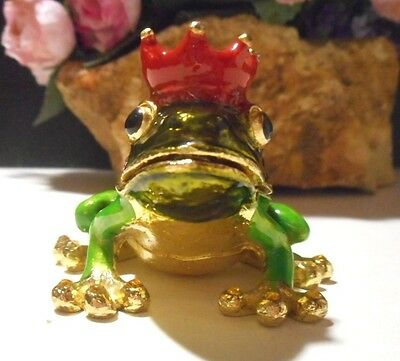 Brass frog prince trinket box with red crown; colors are; green, gold, red.