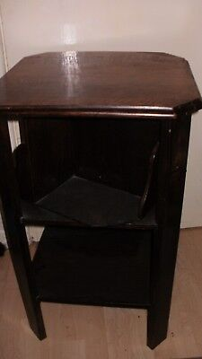 an art deco hexagon solid oak occasional table with revolving bookcase carosell