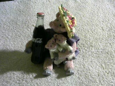 2000 Hogs and Kisses figurine (pig holding a bottle of coke)