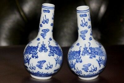 Chinese Vintage Pair Of Small Blue And White Dragon Vases
