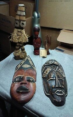 Interesting lot of african wood carvings including figures,masks and ring holder