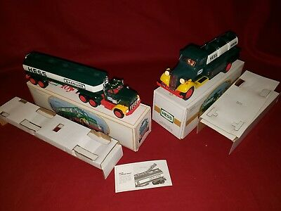 1982 ,1984 hess tanker trucks original box and inserts never used lights work