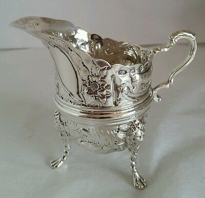 A sterling silver cream jug . Birmingham 1893. By George Nathan & Ridley Hayes