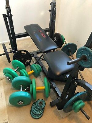 Weight Bench Press and numerous weights with dumbbells and barbell