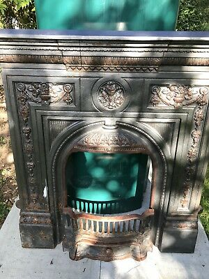Victorian cast iron fireplace surround with grate