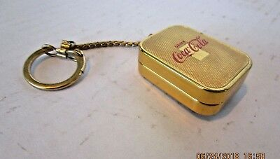 Vintage Coca Cola music box and key chain-combined
