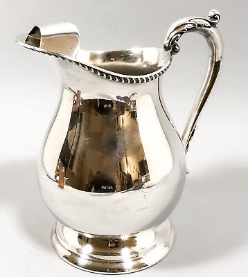 Vintage silver plate footed water pitcher large jug ice guard acanthus handle