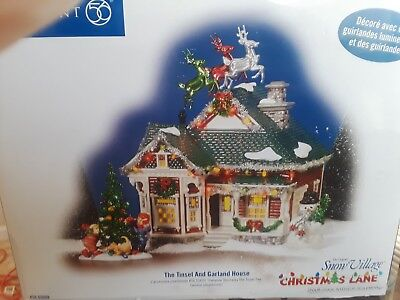 DEPT 56 Snow Village Christmas Lane THE TINSEL AND GARLAND HOUSE
