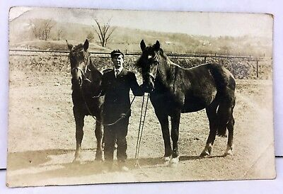 Antique 1913 RPPC Real Photo Postcard MAN LEADING TWO HORSES