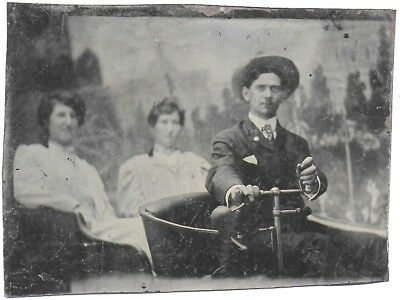 Tintype of Man Posed Driving Two Women in a very Old Automobile c1890s