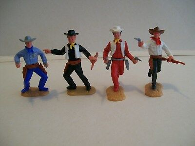 timpo cowboys in good condition 1 white hat painted & 1 sheriff star painted on