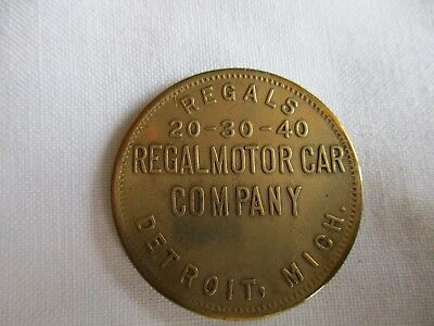 "1910 Regal Motor Car Co.Token, ""Drive A Regal"" Heads I Win, Tails You Lose""."