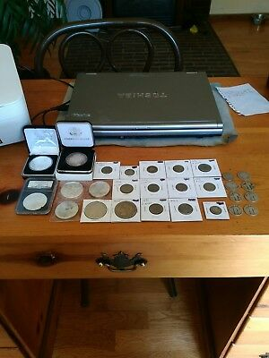 A Large Lot Of silver coins. Eagles, Quarters, V Nickels,Etc...