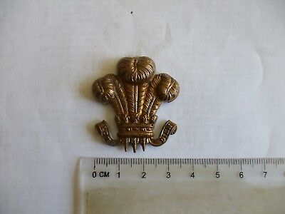 Original  P.of Wales Plumes cap badge,  all brass economy version.