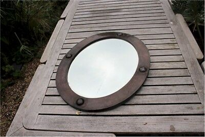 Arts and crafts oval copper mirror with raised roundels Liberty