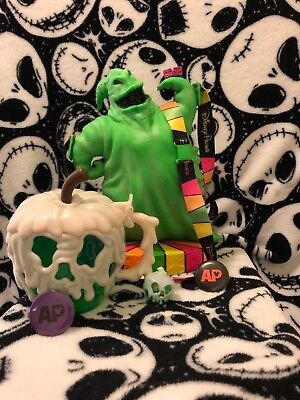 Disney Oogie Boogie popcorn bucket poison apple and glow cube plus AP buttons